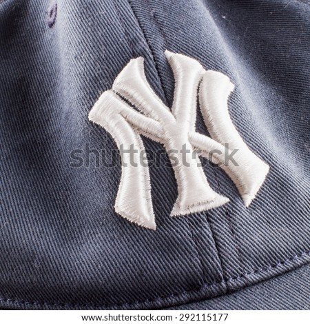 CASALE MONFERRATO, June 29, 2015: New York Yankees symbol over blue cap. New York Yankees are the most famous american baseball franchise.  - stock photo