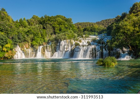 Cascade of waterfalls Skradinski Buk on a sunny day. Krka National Park, Croatia. - stock photo