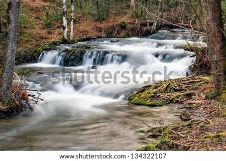 Cascade on Mill Creek near the west end of Cades Cove in Great Smoky Mountains National Park, Tennessee, USA. - stock photo
