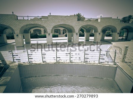 Cascade pool with blue water at the hotel in Egypt. Toned. - stock photo