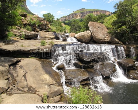 cascades on mahai river in  royal natal park, dragensberg mountains - stock photo