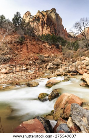 Cascading water falls on the Virgin River at the base of the Court of the Patriarchs at Zion National Park. - stock photo