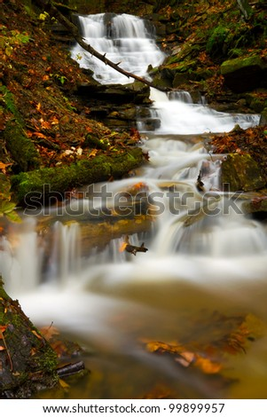 Cascading waterfall during autumn located in Oil Creek State Park. - stock photo