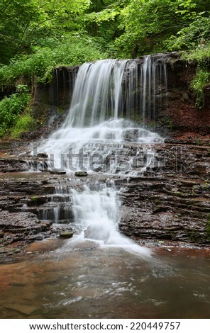 Cascading waterfall in the forest in the Ternopil region. Ukraine. - stock photo
