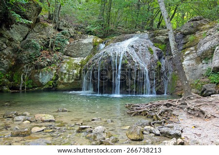 Cascading waterfalls on the river Ulu-Uzen East (Megapotamo) on the southern coast of the Crimea in the gorge Khaphal, Russia. The territory of the state of the hydrological reserve - stock photo