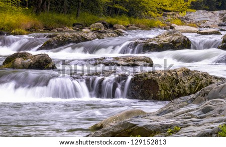 Cascading white water at Roaring Fork stream in the Smokies - stock photo