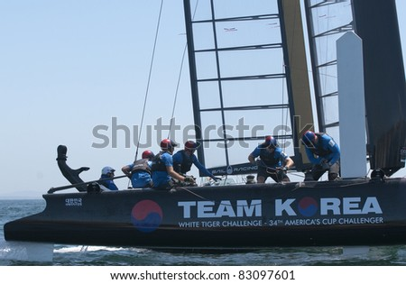 CASCAIS, PORTUGAL - AUGUST 14: America's Cup AC World Series - Fleet Race - Team Korea - Sail Korea Yacht Club  in Cascais, Portugal, August 14, 2011 - stock photo