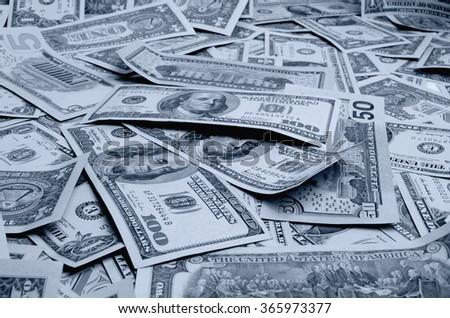 Cash dollars lying on the plane. - stock photo