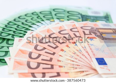Cash Euro hundred and fifty banknotes spread out on the table. - stock photo