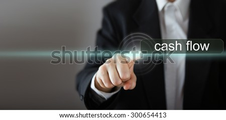 """cash flow. Businessman's hand pressing the icon with text """"cash flow"""" on virtual screens. Business, technology, internet and networking concept. Copy space. - stock photo"""