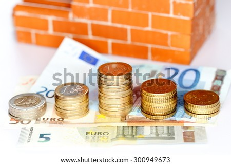 cash money in front of a brick wall - stock photo