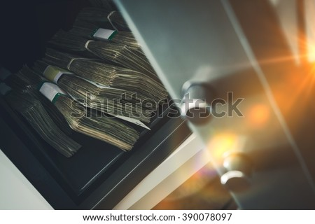 Cash Money Safe Deposit. Small Residential Vault with Pile of Cash Money. Closeup Photo. - stock photo