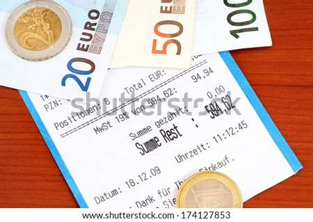 Cash receipt on a brown table - stock photo
