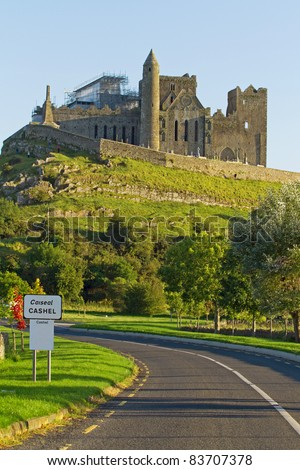 Cashel sign with Rock of Cashel in background - Ireland - stock photo
