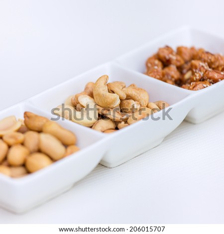Cashew in a bowl on white - stock photo