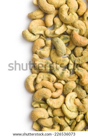 cashew nuts coated wasabi on white background - stock photo