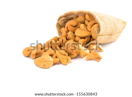 Cashew nuts in a sack with isolated white background - stock photo