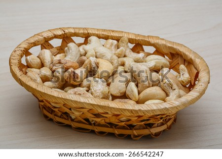 Cashew nuts in the bowl on wood background - stock photo