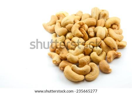 Cashew nuts on white background - stock photo
