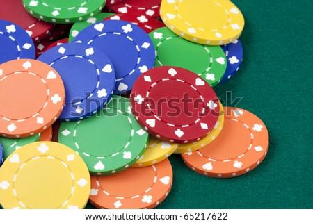 Casino chips, red, yellow, green, orange - stock photo
