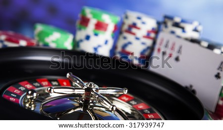 Casino roulette and playing chips - stock photo
