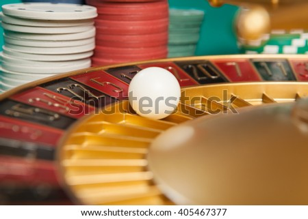 casino roulette wheel with the ball on number 5 - stock photo