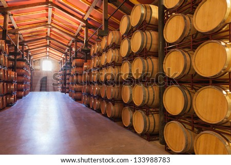 Casks old red wine in a cellar - stock photo