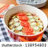 Casserole dish with tomatoes, zucchinis, cheese and ground beef. Baked  testy food. - stock photo