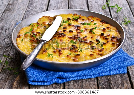 Casserole of vegetables with pine nuts in a metal baking dish - stock photo