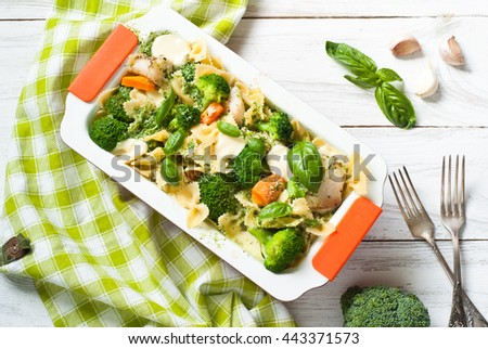 Casserole pasta with fish and broccoli with cream sauce and cheese with garlic. - stock photo
