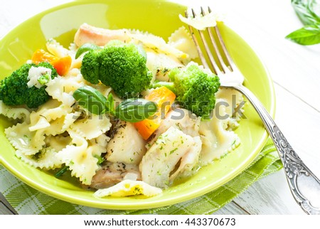 Casserole pasta with fish and broccoli with cream sauce. Summer dish. - stock photo