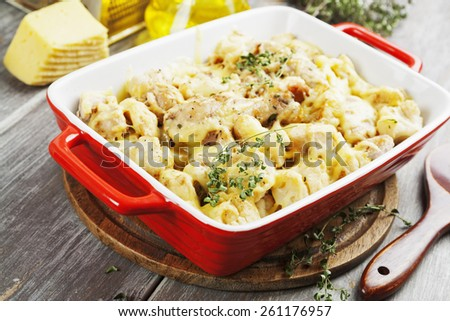 Casserole with cauliflower, chicken and cheese in a ceramic pot - stock photo