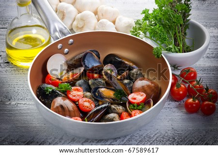 casserole with mix of mollusk - stock photo