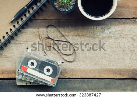 Cassette tapes on wooden table.vintage effect. - stock photo