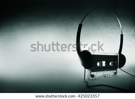 cassette with headphones on background - stock photo