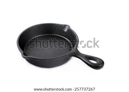 cast iron pan isolated on white background - stock photo