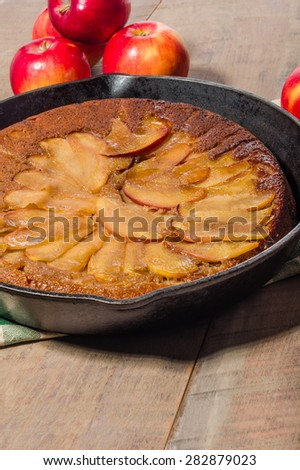 Cast iron skillet apple cake with apples and apple slices - stock photo