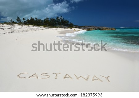 Castaway writing on a desrt beach of Little Exuma, Bahamas - stock photo