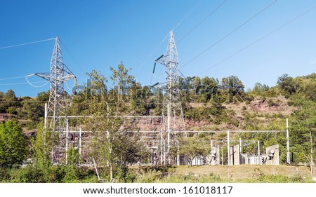 Castejon power plant from sos in the Spanish province of Huesca. Turrets are surrounded by trees on a clear day - stock photo
