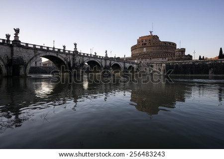Castel Sant'Angelo next to the river tiber sunset. - stock photo
