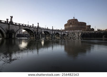 Castel Sant'Angelo next to the river tiber taken during sunset. - stock photo
