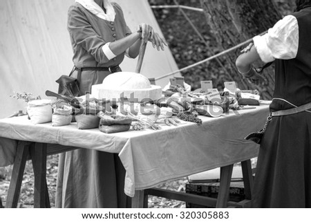CASTELL'ARQUATO, ITALY/PIACENZA, SEPTEMBER 12, 2015: stall of a medieval herbal, with several products on display, during a festival of historical reenactment. Castell'Arquato, September 12, 2015. - stock photo