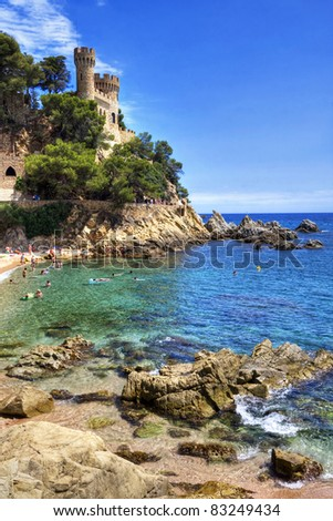 Castell d'en Plaja situated at the end of the Sa Caleta beac in Lloret de Mar, Costa Brava, Spain. - stock photo