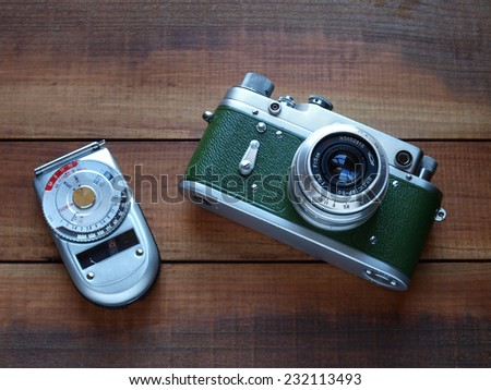 Castellon,Spain.November 21,2014.Old style russian camera against wooden background - stock photo