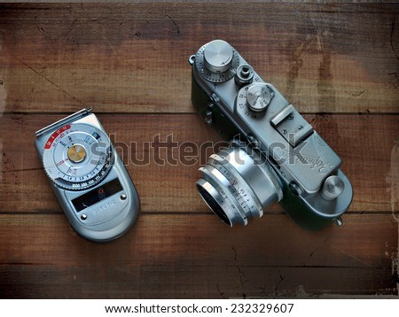 Castellon,Spain.November 22,2014.Photo of a telemetric camera with an exposure meter on a wooden table,composition with an old appearance     - stock photo