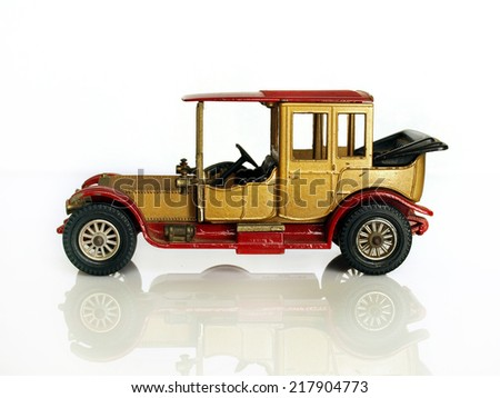 Castellon,Spain - September 17,2014: Small collectible car against white background,british Rolls Royce - stock photo