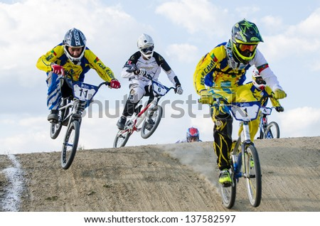CASTELO BRANCO, PORTUGAL - MAY 4: Dario Piedade leading at the 2nd stage of the Portuguese BMX race Cup the  on may 4, 2013 in Castelo Branco, Portugal. - stock photo