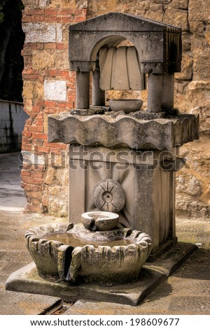 CASTIGLIONE DEL LAGO, TUSCANY/ITALY - MAY 20 : Drinking water fountain for people and animals in  Castiglione del Lago Tuscany on May 20, 2013 - stock photo