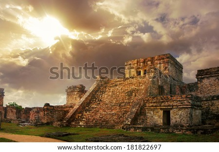 Castillo fortress at sunrise in the ancient Mayan city of Tulum, Mexico - stock photo