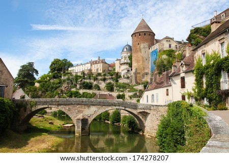 Castle and Pont Pinard over the river Armancon in the historic town of Semur en Auxois in Burgundy, France. - stock photo